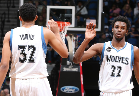 MINNEAPOLIS, MN -  NOVEMBER 25:  Andrew Wiggins #22 of the Minnesota Timberwolves shakes hands with Karl-Anthony Towns #32 of the Minnesota Timberwolves during the game against the Atlanta Hawks on November 25, 2015 at Target Center in Minneapolis, Minnesota. NOTE TO USER: User expressly acknowledges and agrees that, by downloading and or using this Photograph, user is consenting to the terms and conditions of the Getty Images License Agreement. Mandatory Copyright Notice: Copyright 2015 NBAE (Photo by David Sherman/NBAE via Getty Images)